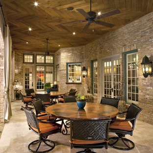 Example of a classic patio design in Dallas with a roof extension