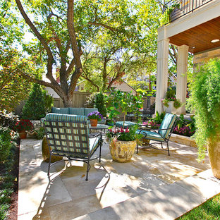 This is an example of a contemporary patio in Austin with natural stone pavers.