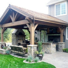Rustic Patio by Ironwood Homes, Inc.