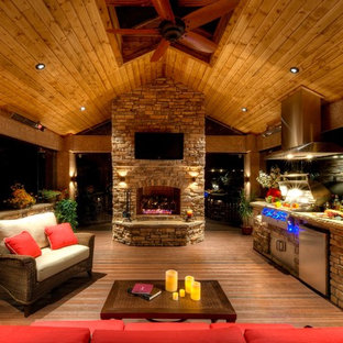 Large mountain style backyard patio kitchen photo in Denver with decking and a gazebo