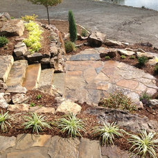 Rustic Patio by Knob Hill Landscape Co.
