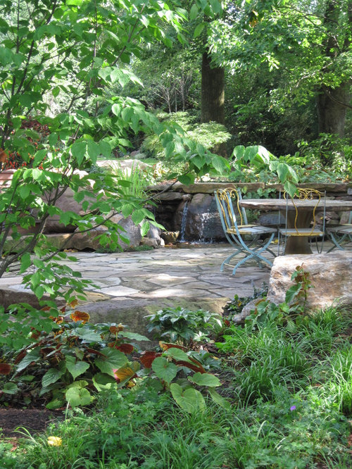 Mid Sized Elegant Backyard Patio Photo In Philadelphia With Natural Stone  Pavers And A Fountain