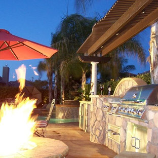 Patio - mid-sized mediterranean backyard concrete patio idea in Other with a fire pit and no cover