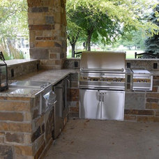 Traditional Patio by Ted Lare Design Build & Garden Center