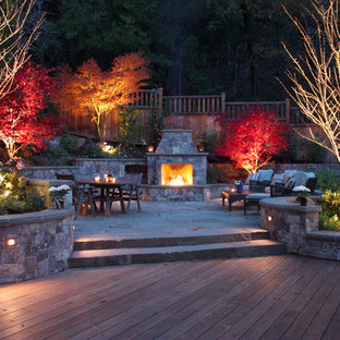 Inspiration for a large timeless backyard stone patio remodel in San Francisco with a fire pit and no cover