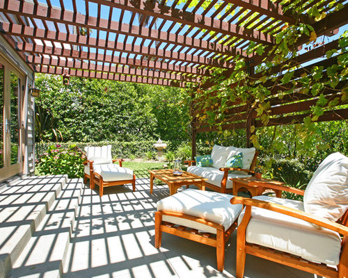 Example Of A Trendy Backyard Patio Design In Orange County With A Pergola