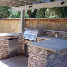 Traditional Patio by Sunset Construction & Design