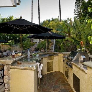 Island style patio kitchen photo in Orange County