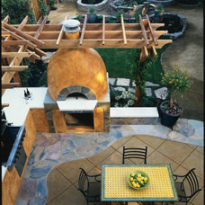 Mediterranean Patio by De Mattei Construction