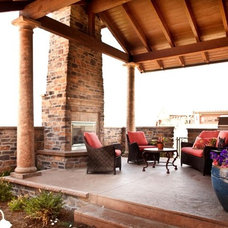 Rustic Patio by Aneka Interiors Inc.