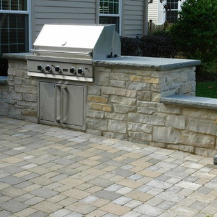 Inspiration for a large timeless backyard brick patio kitchen remodel in Chicago with no cover