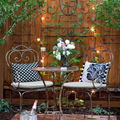 Patio kitchen - mid-sized transitional backyard stone patio kitchen idea in Denver