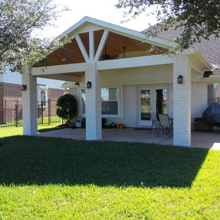 Patio - mid-sized craftsman backyard concrete patio idea in Houston with a roof extension