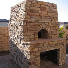 Traditional Patio by Custom Masonry & Fireplace Design Inc