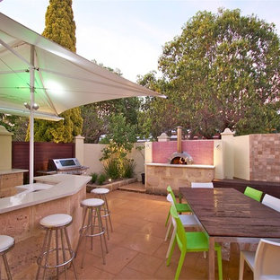 Inspiration for a contemporary patio in Perth with a fire feature.