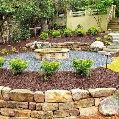 Example of a mid-sized classic backyard gravel patio design in Atlanta with a fire pit