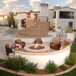 Example of a large tuscan backyard tile patio design in Phoenix with a fire pit