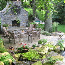 Traditional Patio by Nature's Expressions