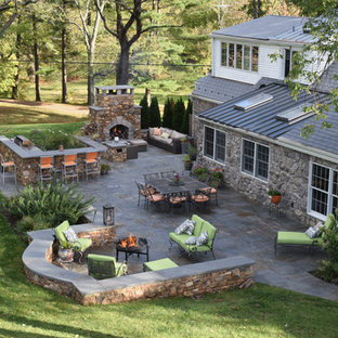 Patio - large craftsman backyard concrete paver patio idea in Philadelphia with a fire pit