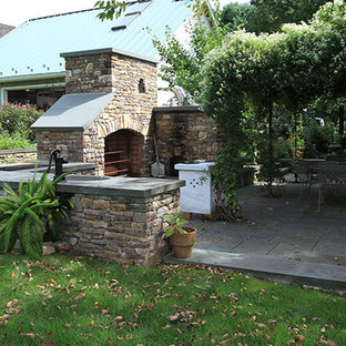 Inspiration for a medium sized victorian back patio in Philadelphia with an outdoor kitchen, concrete paving and no cover.
