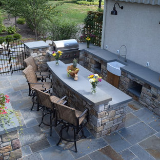 Patio kitchen - mid-sized craftsman backyard concrete paver patio kitchen idea in Philadelphia with no cover