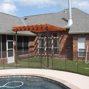 Example of a small classic backyard patio design in New Orleans with a pergola