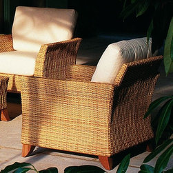 Outdoor Wicker Lounge Chair - This Rausch outdoor wicker lounge chair offers deep seating cushions and a matching sofa and coffee table.