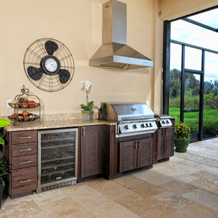 Large transitional backyard concrete paver patio kitchen photo in Other with a roof extension
