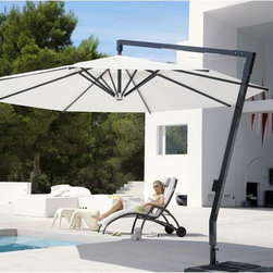 Outset Rotating Umbrella - This offset style umbrella allows the canopy to rotate in circle for perfect shade placement.