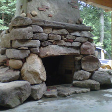 Eclectic Patio by Poole's Stone and Garden, Inc.