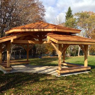 Patio - mid-sized traditional backyard concrete patio idea in Portland Maine with a gazebo