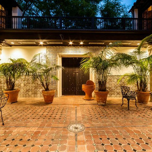 Photo of a large mediterranean courtyard patio in Los Angeles with tile and no cover.