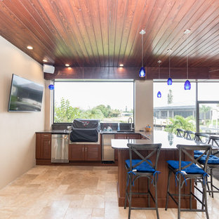 Inspiration for a mid-sized timeless backyard tile patio kitchen remodel in Miami with a roof extension