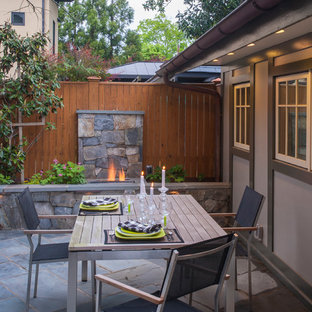 Example of an arts and crafts patio design in DC Metro with a fire pit and no cover