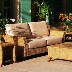 Palm Beach Outdoor Wicker Sofa - The Palm Beach outdoor wicker sofa has deep seating cushions and matching arm chairs and casual tables.