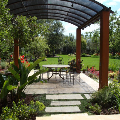 Example of a large tuscan backyard concrete paver patio design in San Francisco with a gazebo