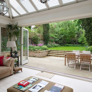 This is an example of a mid-sized contemporary backyard patio in London with no cover.