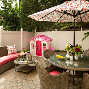 Inspiration for a medium sized traditional back patio in New York with concrete paving and an awning.