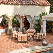 Mediterranean Patio by Kathryne Designs, Inc