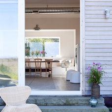 Farmhouse Patio by ZeroEnergy Design