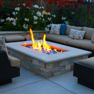 Patio - mid-sized modern backyard concrete paver patio idea in San Francisco with a fire pit and no cover
