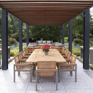 Example of a trendy patio design in Minneapolis with a pergola