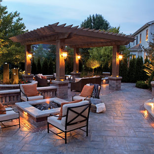 Patio by Unilock with Rivenstone and Copthorne paver and firepit