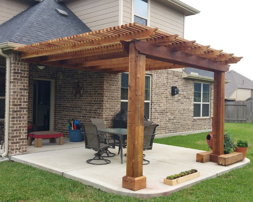 Inspiration For A Mid Sized Timeless Backyard Concrete Patio Remodel In  Houston With A Pergola