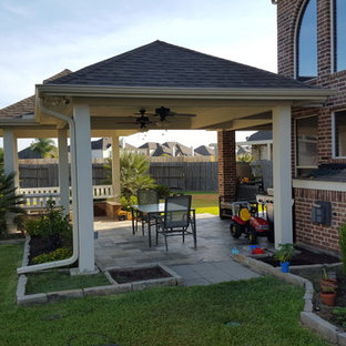 Patio - mid-sized traditional backyard patio idea in Houston with a fire pit and a roof extension