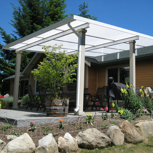 Inspiration for a medium sized farmhouse back patio in Seattle with an awning.