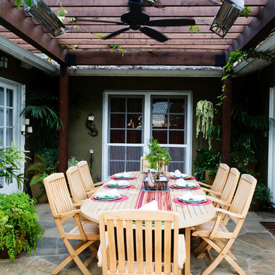 Example of a trendy patio design in Los Angeles with a pergola