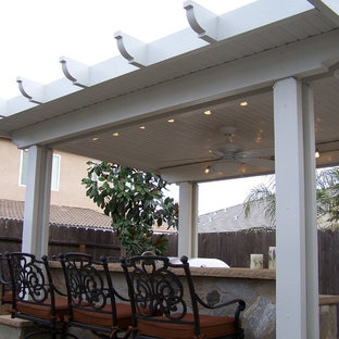 Inspiration for a small classic back patio in Other with an outdoor kitchen, concrete slabs and a gazebo.
