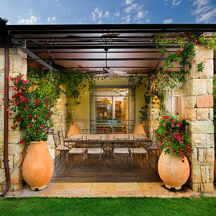This is an example of a mediterranean patio in Other with a gazebo/cabana.