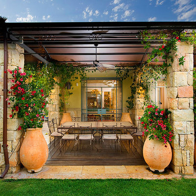 Tuscan patio photo in Other with a gazebo